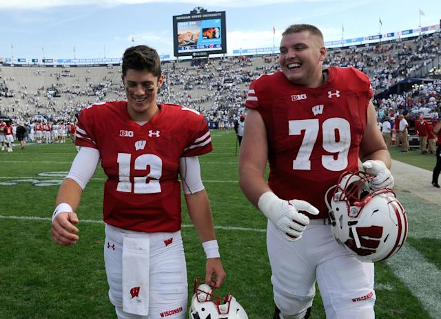 "<a class=""link rapid-noclick-resp"" href=""/ncaaf/players/251340/"" data-ylk=""slk:Alex Hornibrook"">Alex Hornibrook</a> (L) and teammate <a class=""link rapid-noclick-resp"" href=""/ncaaf/players/255370/"" data-ylk=""slk:David Edwards"">David Edwards</a> walk off the field after their 40-6 win over the Brigham Young Cougars. (Photo by Gene Sweeney Jr/Getty Images)"