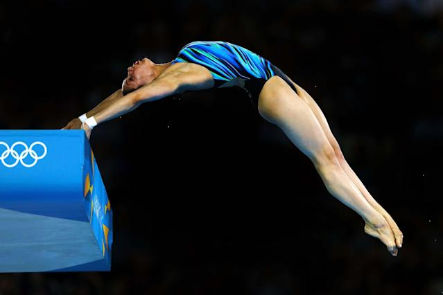 LONDON, ENGLAND - AUGUST 08: Yulia Koltunova of Russia competes in the Women's 10m Platform Diving Preliminary on Day 12 of the London 2012 Olympic Games at the Aquatics Centre on August 8, 2012 in London, England. (Photo by Al Bello/Getty Images)