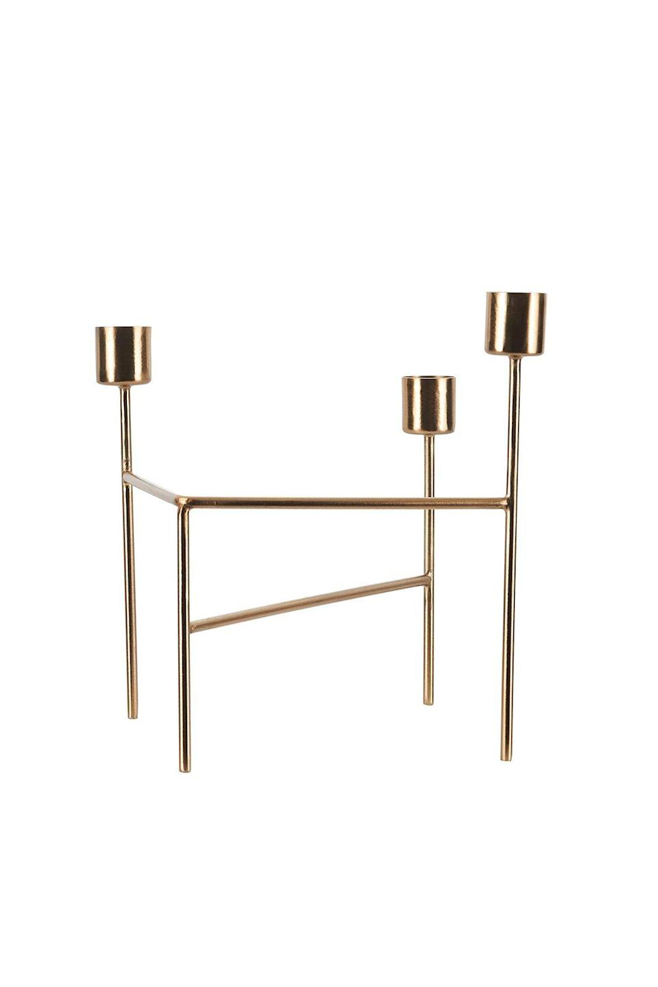 """<p><strong>Flaming hot</strong></p><p>Light up your dinner table with this brushed brass candle holder and bestow a bit of magic on your next gathering. A little bit of candlelight never hurt any slightly less than perfect cooking, after all.</p><p>£16, <a href=""""https://www.amara.com/products/candle-holder-brushed-brass"""" rel=""""nofollow noopener"""" target=""""_blank"""" data-ylk=""""slk:amara.com"""" class=""""link rapid-noclick-resp"""">amara.com</a></p>"""