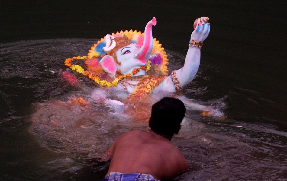 A Ganesh idol joins thousands of others being immersed in the river. A study conducted in the Ganga River in the aftermath of the similar immersion of Durga idols during the Pujo festival estimated that the total amount of paint submerged in the river was approximately 15 tons. They caused the levels of heavy metals such as mercury, chromium and copper and zinc sulphites to increase by as much as 20 times the normal between October and January. Only during the monsoon, when water levels rise in Indian rivers, does the level of pollutants diminish.