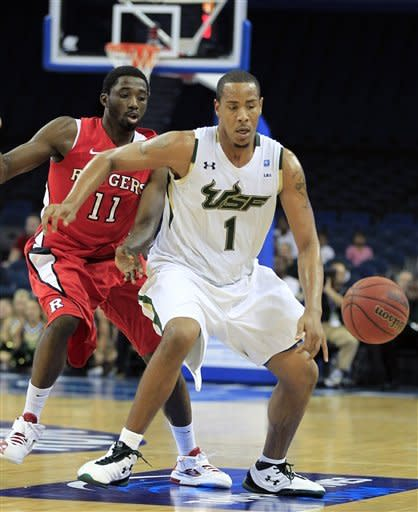 South Florida forward Ron Anderson Jr. (1) chases the basketball after knocking it away from Rutgers guard Dane Miller (11) during the second half of an NCAA college basketball game Sunday Jan. 1, 2012, in Tampa, Fla. (AP Photo/Chris O'Meara)