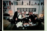 <p>After the awards show, Kirk celebrates his Oscar win with his family at home. The Hollywood star is photographed on his couch with his sons Michael, Peter, Joel, and Eric, as well as his wife Anne Buydens. </p>