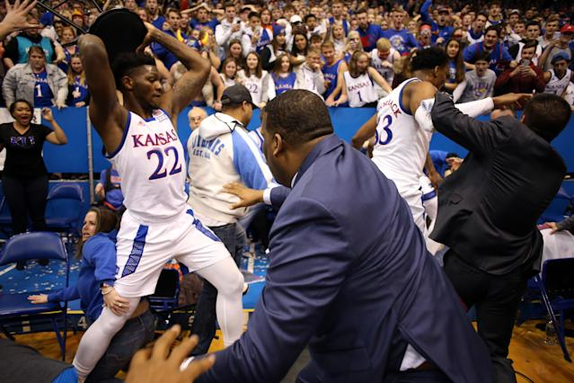 Kansas State will host Kansas on Saturday afternoon in Manhattan, the first meeting between the teams since a massive brawl broke out in their game last month. (Jamie Squire/Getty Images)