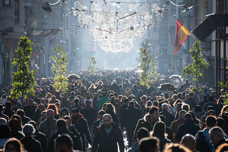 Crowds of pedestrians and tourists enjoy a sunny day on Istiklal street, a historic commercial and shopping area and public urban space of Istanbul on February 17.