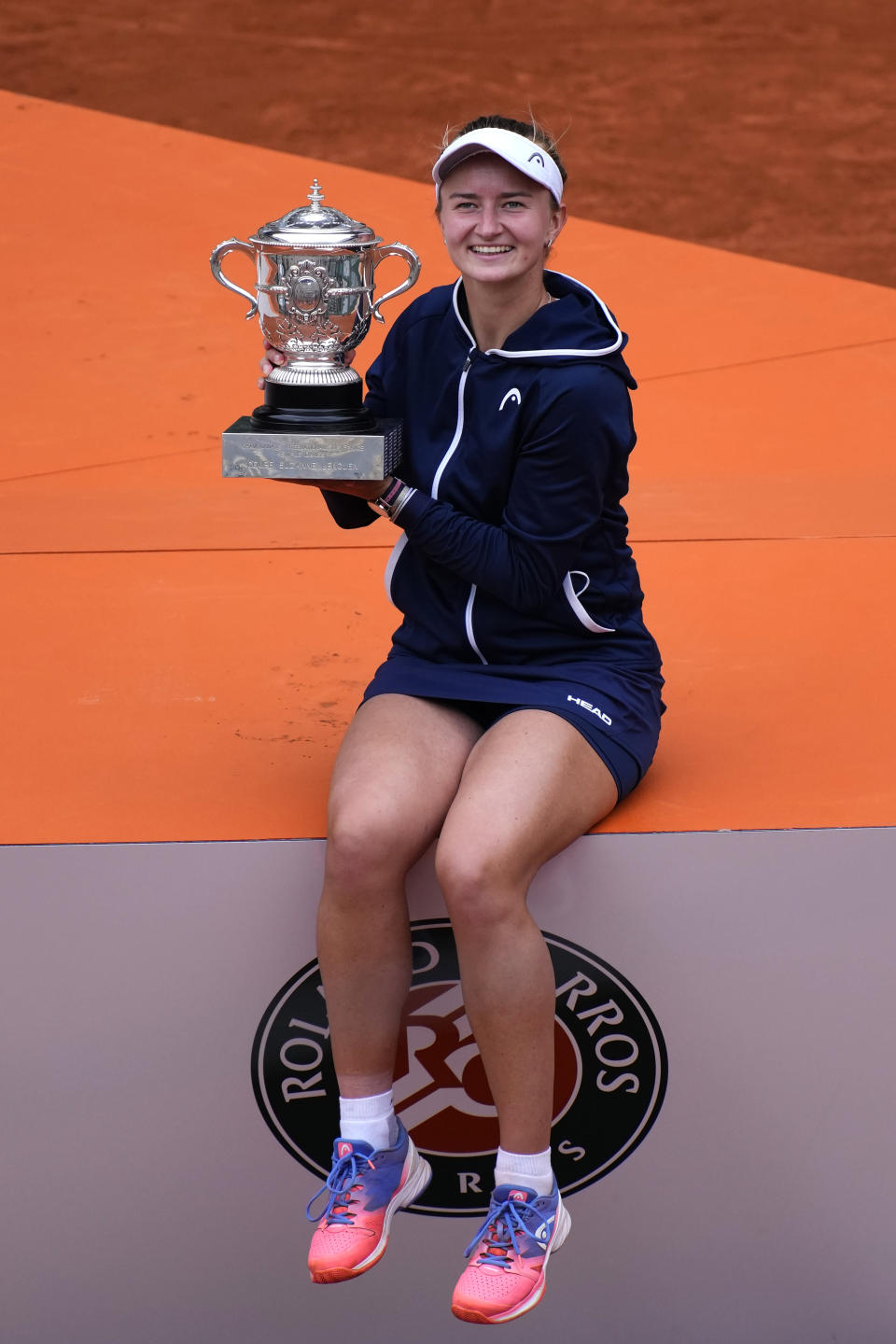 Czech Republic's Barbora Krejcikova poses with the cup after defeating Russia's Anastasia Pavlyuchenkova in their final match of the French Open tennis tournament at the Roland Garros stadium Saturday, June 12, 2021 in Paris. The unseeded Czech player defeated Anastasia Pavlyuchenkova 6-1, 2-6, 6-4 in the final. (AP Photo/Christophe Ena)