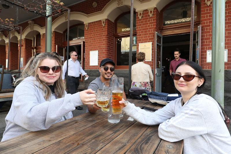 FREMANTLE, AUSTRALIA - MAY 18: Customers enjoy a beer at the National Hotel on May 18, 2020 in Fremantle, Australia. COVID-19 restrictions have further eased across Western Australia in response to the state's declining infection rate. From Monday 18 May, restaurants and cafes can open for up to 20 patrons to dine in, while indoor and outdoor gatherings of up to 20 people are also permitted. Regional travel boundaries have also been eased, with temporary regional borders reduced from 13 to four. Travel is permitted within the Mid-West, Gascoyne and Pilbara, the Goldfields-Esperance region and within the Kimberley. While travel between South West, Great Southern, Wheatbelt and Peel regions to Perth is also now permitted.Travel between Perth and the other regions remains prohibited, and Western Australia's interstate border also remains closed. (Photo by Paul Kane/Getty Images)