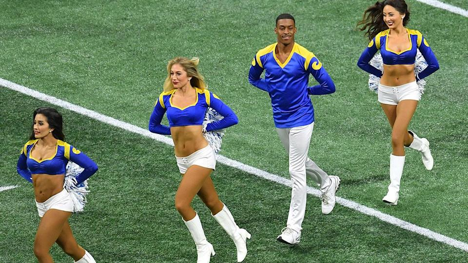 Quinton Peron performs with other cheerleaders. (Photo by ANGELA WEISS/AFP/Getty Images)