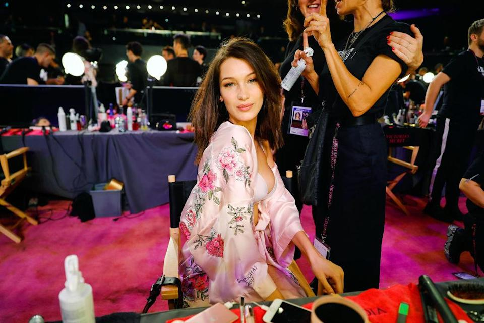 Bella Hadid posing during hair and makeup. (Photo: Getty Images)
