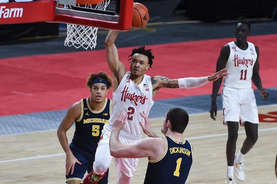 Cornhuskers guard Trey McGowens (2) drives against Michigan center Hunter Dickinson (1) and forward Terrance Williams II (5) in the first half at Pinnacle Bank Arena on Friday, Dec. 25, 2020.