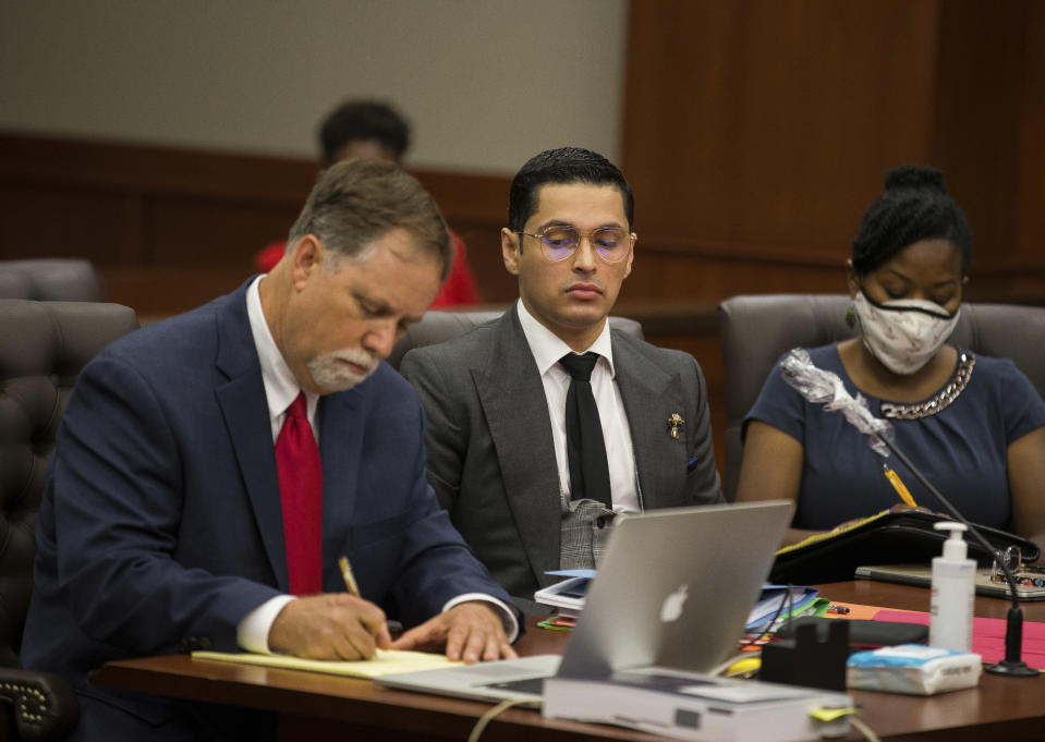 Attorney Michael Elliott and his client Victor Hugo Cuevas, a 26-year-old linked to a missing tiger named India, attend a bond revocation hearing on a separate murder charge at Fort Bend County Justice Center on Friday, May 14, 2021, in Richmond, Texas. (Godofredo A. Vásquez/Houston Chronicle via AP)