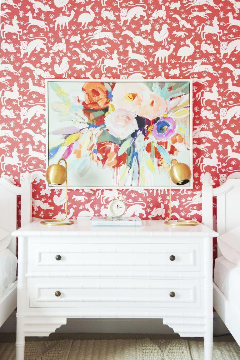 """<p>This vibrant hue is both invigorating and energizing and will add a dash of happiness wherever you put it. To make a serious statement, try a coral wallpaper in a small space like your <a href=""""https://www.goodhousekeeping.com/home/organizing/g25575495/mudroom-ideas/"""" rel=""""nofollow noopener"""" target=""""_blank"""" data-ylk=""""slk:mudroom"""" class=""""link rapid-noclick-resp"""">mudroom</a>, bathroom, home office, or laundry room. </p><p><strong>RELATED: </strong><a href=""""https://www.goodhousekeeping.com/home/decorating-ideas/g2000/decor-ideas-bathroom/"""" rel=""""nofollow noopener"""" target=""""_blank"""" data-ylk=""""slk:50 Bathroom Decorating Ideas for the Fastest and Freshest Makeover"""" class=""""link rapid-noclick-resp"""">50 Bathroom Decorating Ideas for the Fastest and Freshest Makeover</a></p>"""