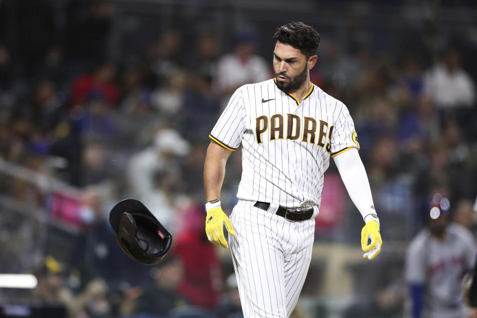 San Diego Padres' Eric Hosmer throws his helmet toward the dugout after striking out against New York Mets starting pitcher Jacob deGrom during the sixth inning of a baseball game Saturday, June 5, 2021, in San Diego. (AP Photo/Derrick Tuskan)