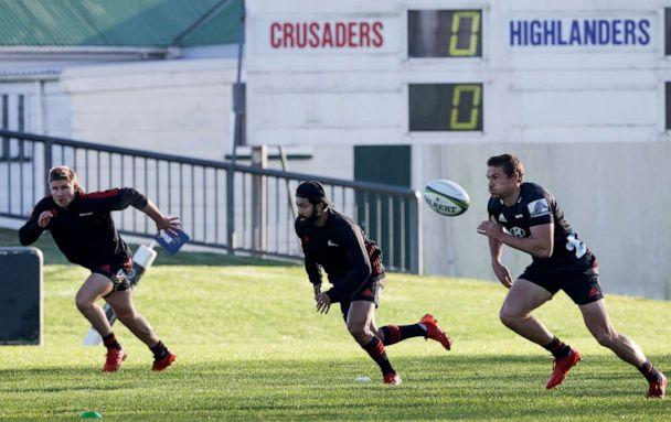 PHOTO: Crusaders players from left, Jack Goodhue, Richie Mo'unga, and George Bridge run during a training session at Rugby Park in Christchurch, New Zealand, May 27, 2020. (Mark Baker/AP)