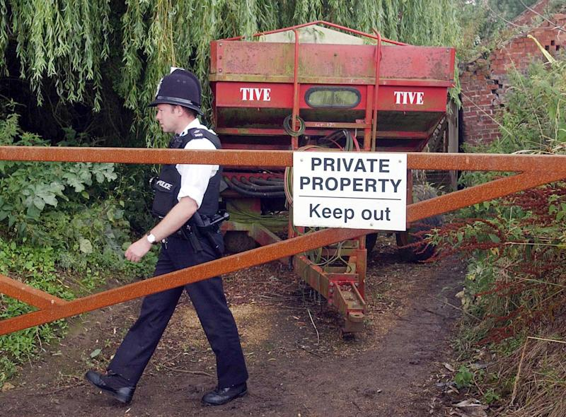 "A Police officer walks around the grounds of Tony Martin's farm in Emneth Hungate, Norfolk. Martin was released from custody after serving two-thirds of his five-year jail sentence for shooting dead a 16-year-old burglar and wounding his accomplice. * A Prison Service spokesman said he was released from an undisclosed location, adding: ""He is now a free man."""