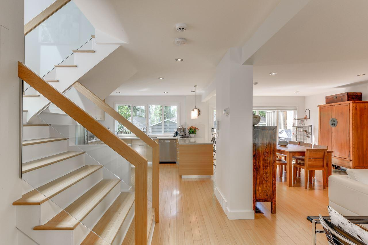 <p>13107 Churchill Cres. Northwest, Edmonton, Alta. There is bamboo flooring throughout and glass-wrapped stairs, adding to the light and airy feel. (Photo: Zoocasa) </p>