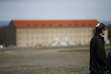 A man wearing a kippah visits the former Nazi concentration camp Buchenwald near Weimar, April 12, 2015. REUTERS/Kai Pfaffenbach
