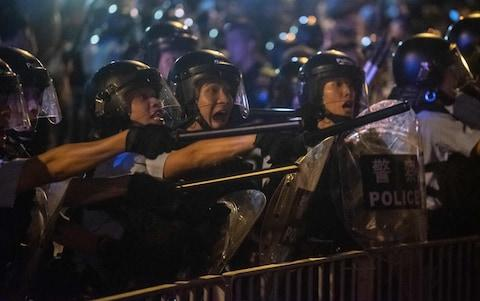 Riot police - Credit: PHILIP FONG/AFP/Getty Images