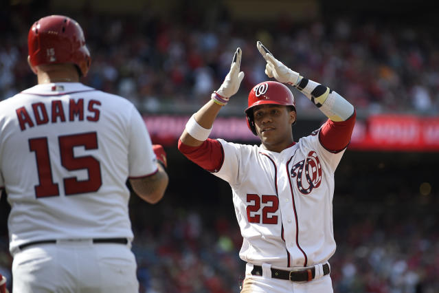 Washington Nationals' Juan Soto (22) celebrates his home run with Matt Adams (15) during the first inning of a baseball game against the Arizona Diamondbacks, Saturday, June 15, 2019, in Washington. (AP Photo/Nick Wass)
