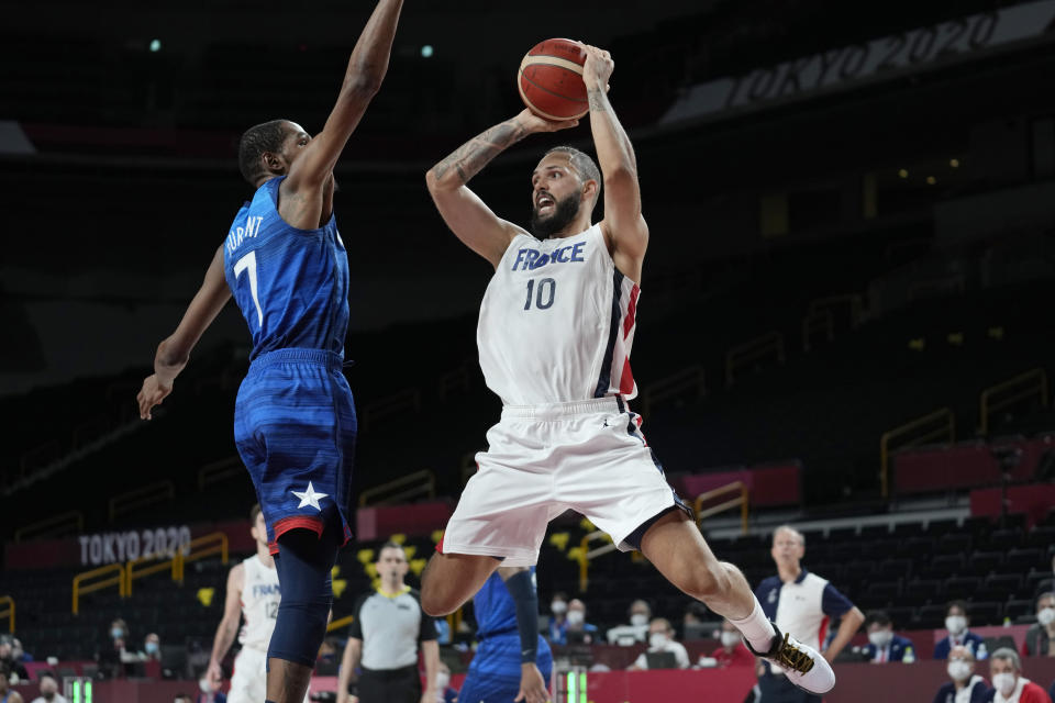 France's Evan Fournier (10) shoots over United States' forward Kevin Durant (7) during a men's basketball preliminary round game at the 2020 Summer Olympics, Sunday, July 25, 2021, in Saitama, Japan. (AP Photo/Eric Gay)