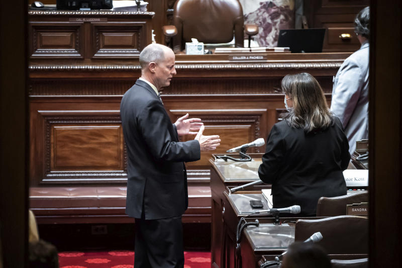 """Senate Majority Leader Paul Gazelka, R-Baxter talks with Senate Minority Leader Susan Kent, DFL-Woodbury on the Senate Floor before the start of a session in St. Paul, Minn. Friday, June 12, 2020. Gazelka said """"Minnesota has the opportunity to lead the way for the whole nation for reconciliation of the races and some of the problems we're addressing. Let's begin here."""" (Glen Stubbe/Star Tribune via AP)"""