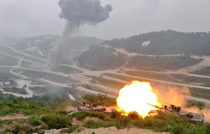 A South Korean K1A1 tank fires live rounds during a joint live-firing drill with the US, at the Seungjin Fire Training Field in Pocheon, north-east of Seoul, in 2012 (AFP Photo/Jung Yeon-Je)