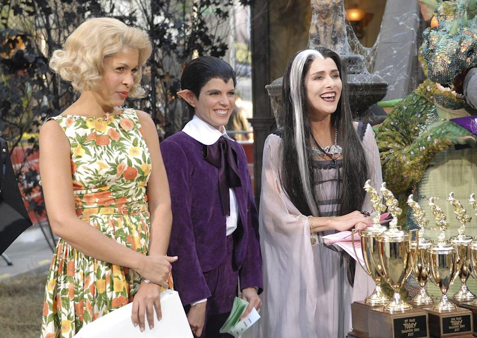 "<p>Channeling all the ghoulishly funny characters from <em>The Munsters</em> sitcom, the <em>Today </em>gang wore disguises that would make America's family of fright proud. Here, Meredith Vieira wore a gray streak in her hair and dressed as Lily while Natalie Morales donned a purple garb and a widows peak as Eddie. Oh, and Hoda Kotb was dressed as the ""plain"" Marilyn. </p>"