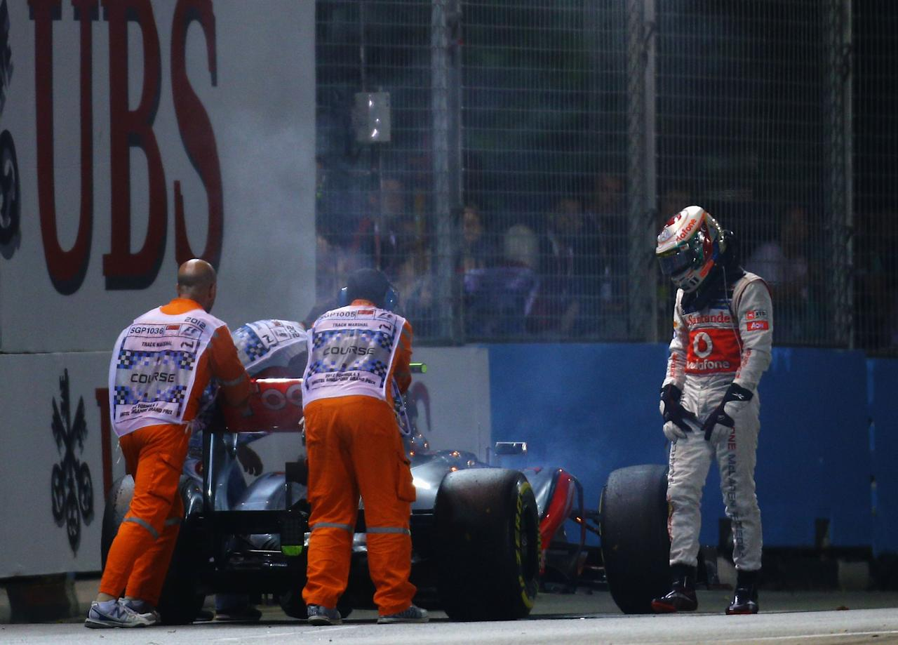 SINGAPORE - SEPTEMBER 23:  Lewis Hamilton of Great Britain and McLaren retires early from the Singapore Formula One Grand Prix at the Marina Bay Street Circuit on September 23, 2012 in Singapore, Singapore.  (Photo by Paul Gilham/Getty Images)