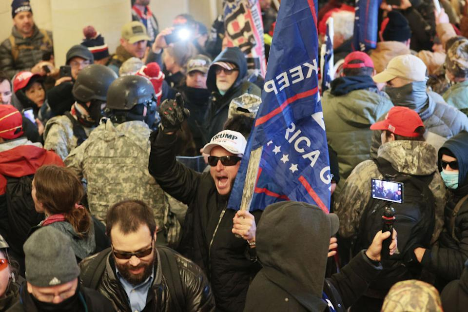 Protesters gather inside the US Capitol Building in Washington, DC, on January 6, 2021.