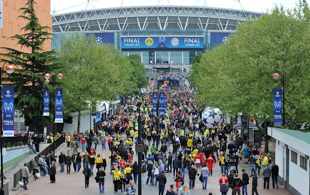 Fans arrive for the UEFA Champions League Final at Wembley Stadium, London.