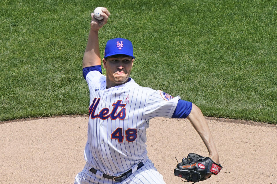 New York Mets starting pitcher Jacob deGrom (48) winds up during the first inning of a baseball game against the Arizona Diamondbacks, Sunday, May 9, 2021, in New York. (AP Photo/Kathy Willens)