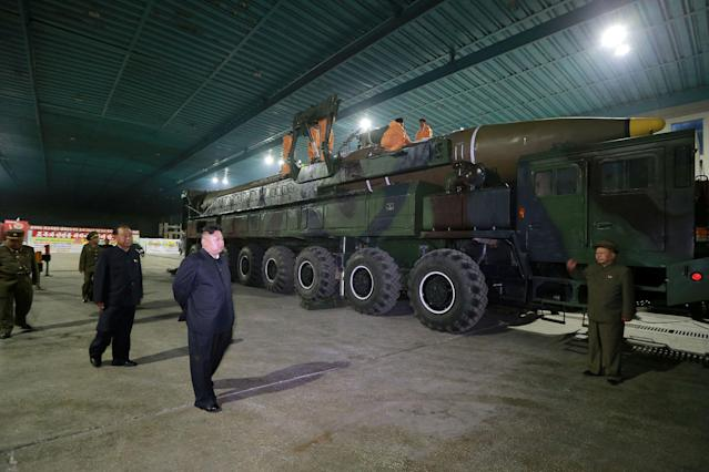 <p>North Korean leader Kim Jong Un inspects the intercontinental ballistic missile Hwasong-14 in this undated photo released by North Korea's Korean Central News Agency (KCNA) in Pyongyang July 5, 2017. (Photo: KCNA/via Reuters) </p>