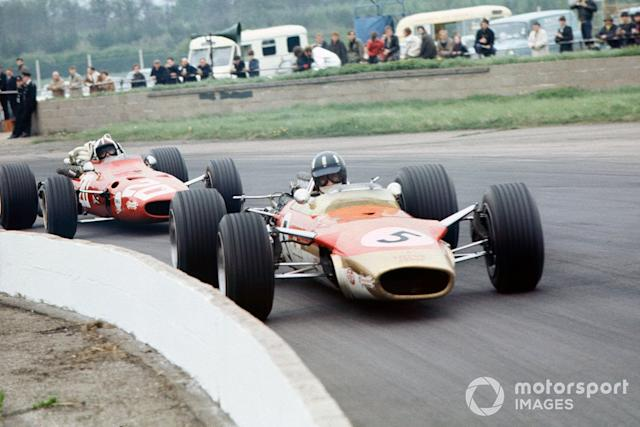 "Graham Hill, Lotus 49B-Ford, leads Chris Amon, Ferrari 312 <span class=""copyright"">LAT Images</span>"