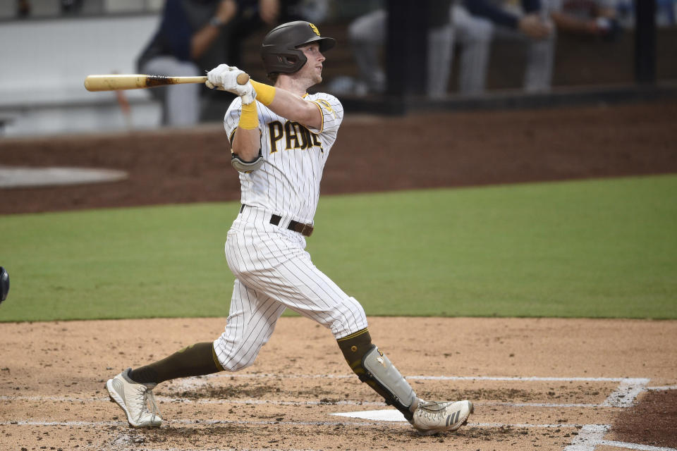 San Diego Padres' Jake Cronenworth watches his grand slam during the second inning of the team's baseball game against the Houston Astros in San Diego, Saturday, Aug. 22, 2020. (AP Photo/Kelvin Kuo)