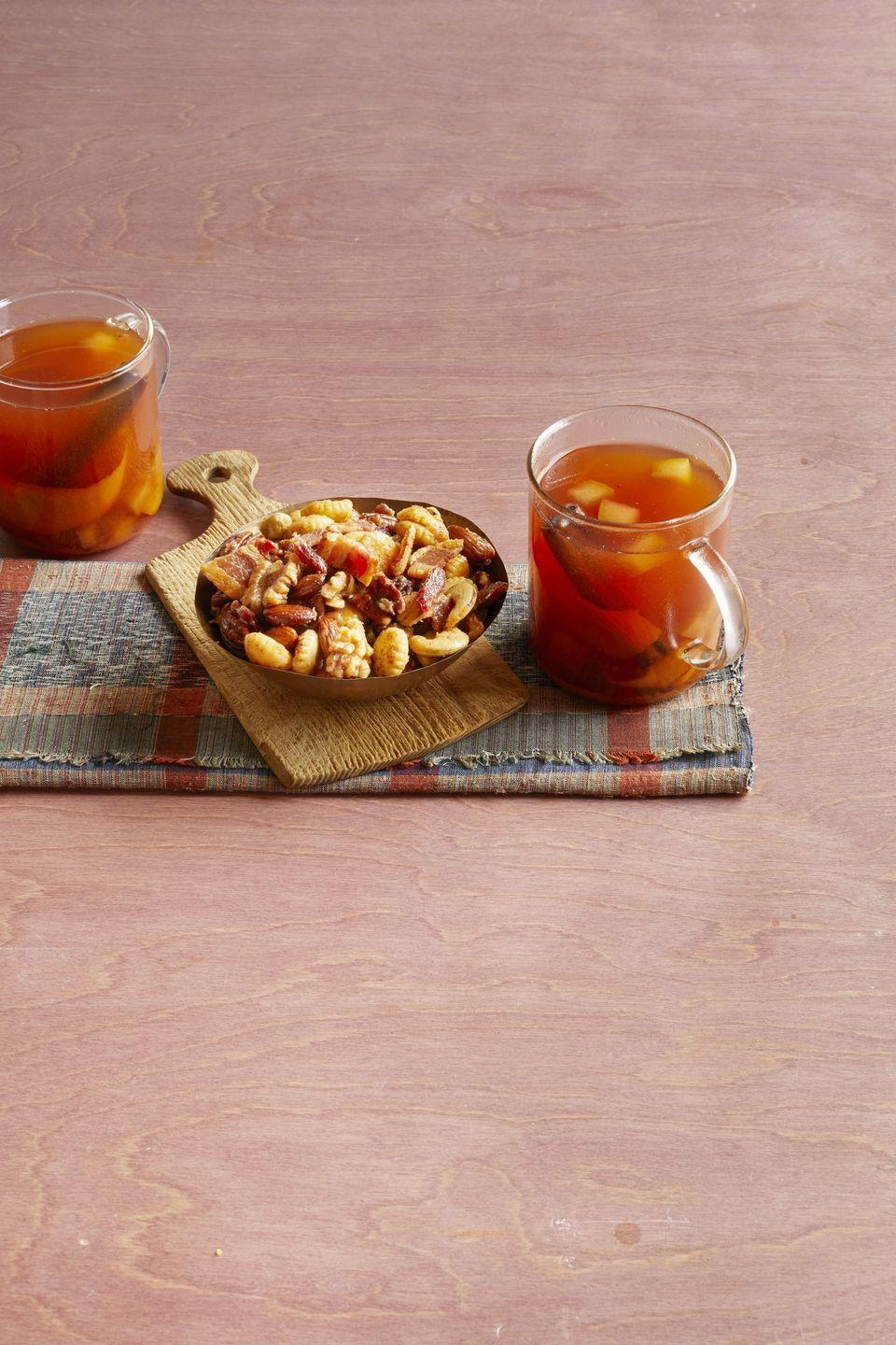 """<p>A splash of bourbon turns this fall favorite into a cozy cocktail. It's the perfect pick-me-up after a day of raking leaves.</p><p><strong><a href=""""https://www.thepioneerwoman.com/food-cooking/recipes/a32304617/mulled-cider-with-bourbon-recipe/"""" rel=""""nofollow noopener"""" target=""""_blank"""" data-ylk=""""slk:Get the recipe."""" class=""""link rapid-noclick-resp"""">Get the recipe.</a></strong></p><p><strong><a class=""""link rapid-noclick-resp"""" href=""""https://go.redirectingat.com?id=74968X1596630&url=https%3A%2F%2Fwww.walmart.com%2Fbrowse%2Fhome%2Fcoffee-mugs%2F4044_623679_639999_3148543_9383607%3Ffacet%3Dbrand%253AThe%2BPioneer%2BWoman&sref=https%3A%2F%2Fwww.thepioneerwoman.com%2Ffood-cooking%2Fmeals-menus%2Fg33510531%2Ffall-cocktail-recipes%2F"""" rel=""""nofollow noopener"""" target=""""_blank"""" data-ylk=""""slk:SHOP MUGS"""">SHOP MUGS</a><br></strong></p>"""