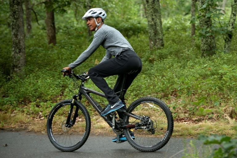 Barack Obama, pictured riding his bike on Martha's Vineyard in August 2015, will celebrate his 60th birthday on the upscale island