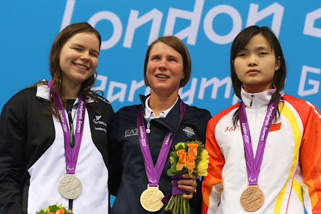 LONDON, ENGLAND - AUGUST 31: (L-R) Silver medallist Mary Fisher of New Zealand, gold medallist Cecilia Camellini of Italy and bronze medallist Guizhi Li of China pose on the podium during the medal ceremony for the Women's 100m Freestyle - S11 Finalon day 2 of the London 2012 Paralympic Games at Aquatics Centre on August 31, 2012 in London, England. (Photo by Clive Rose/Getty Images)