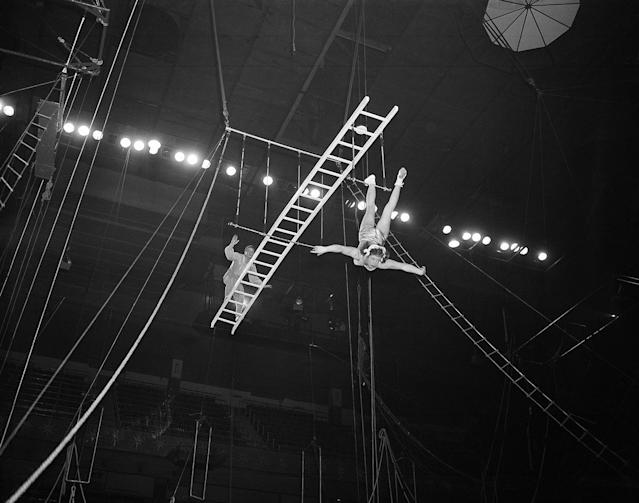 <p>The Rixos on their balanced ladder on a trapeze rehearse their act for Ringling Bros. and Barnum and Bailey Circus at Madison Square Garden, New York, March 30, 1954. (AP Photo/Matty Zimmerman) </p>