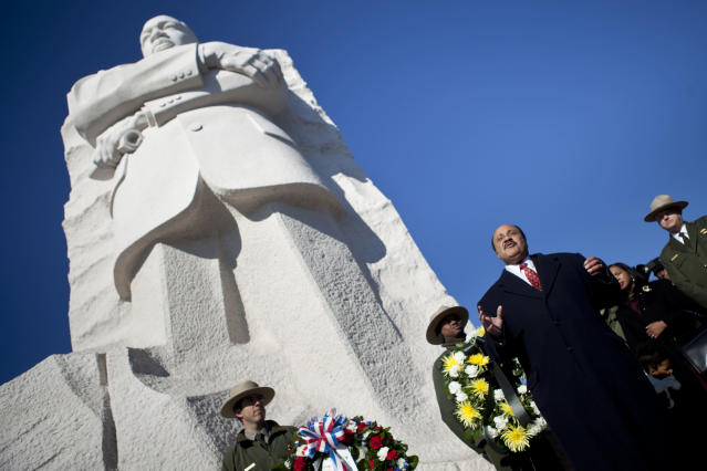 WASHINGTON, DC - JANUARY 15: Marin Luther King III speaks at the base of a statue to his father after a wreath laying ceremony at the Martin Luther King Jr. memorial on the National Mall January 15, 2012 in Washington, DC. Martin Luther King III and others joined to lay a wreath at the memorial to Rev. Dr. Martin Luther King Jr. to honor the 83rd birthday of the American Civil Rights leader who was assassinated in 1968. (Photo by Brendan Smialowski/Getty Images)