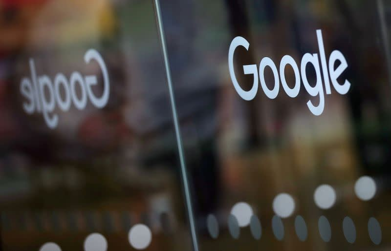 FILE PHOTO: The Google logo is pictured at the entrance to the Google offices in London