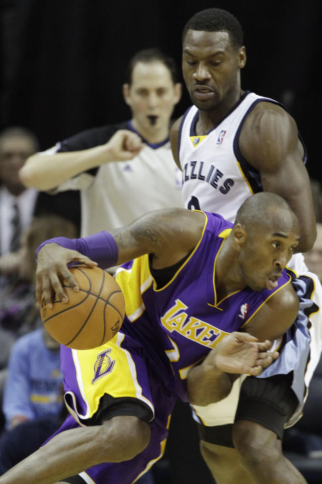 Los Angeles Lakers' Kobe Bryant, bottom, works the ball against Memphis Grizzlies' Tony Allen during the second half of an NBA basketball game in Memphis, Tenn., Tuesday, Dec. 17, 2013. The Lakers defeated the Grizzlies 96-92. (AP Photo/Danny Johnston)