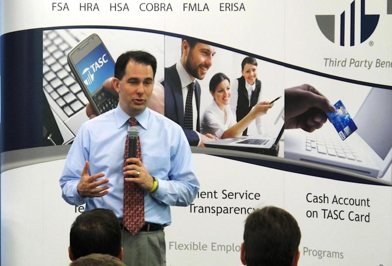 Wisconsin Gov. Scott Walker speaks to employees of Total Administrative Services Corp., on Monday, May 21, 2012, in Madison, Wis. Walker, who faces a recall election in two weeks, is up in the polls and appears to have the momentum in the race. (AP Photo/Scott Bauer)