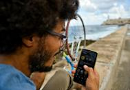 Thanks to mobile internet, Yasser Gonzalez now uses Facebook to organize monthly cycling events