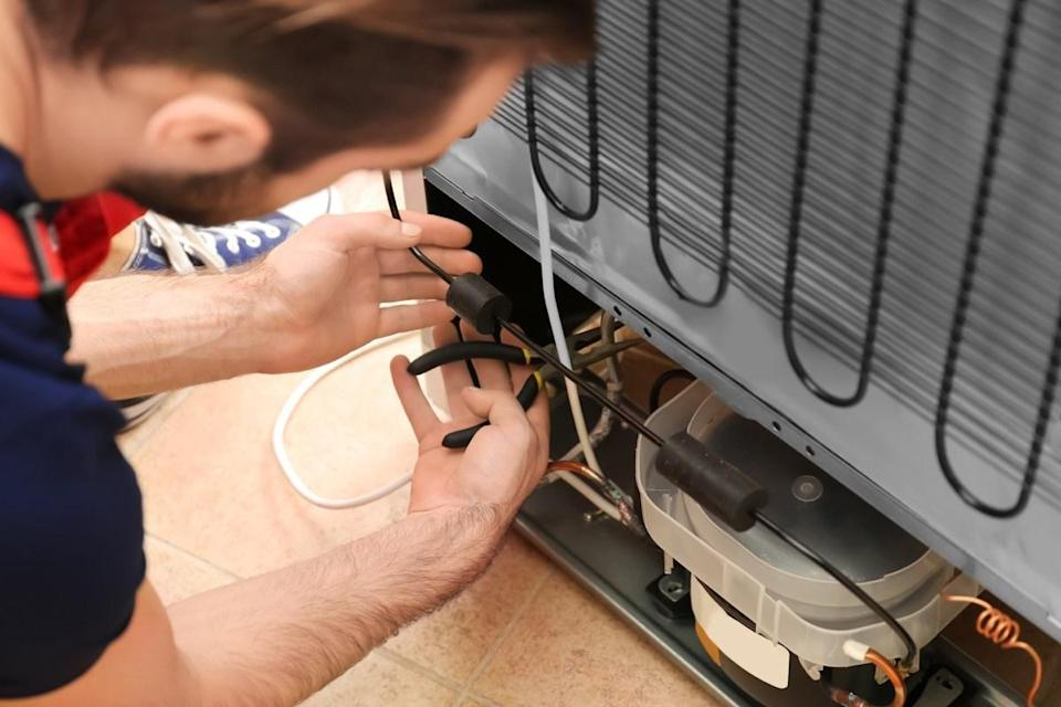 """You may clean out the inside of your refrigerator on a regular basis, but if you're not cleaning its condenser coil, you're making a fatal fridge error. """"If you've noticed that your fridge is constantly running but doesn't seem to be cold enough, then you'll need to clean your condenser coil,"""" says <strong>Brett Elron</strong>, owner and lead interior designer at <a href=""""https://barterdesign.co/"""" rel=""""nofollow noopener"""" target=""""_blank"""" data-ylk=""""slk:Barter Design"""" class=""""link rapid-noclick-resp"""">Barter Design</a>, an interior design consulting firm in New York. Failing to do so may even shorten the lifespan of your appliance."""