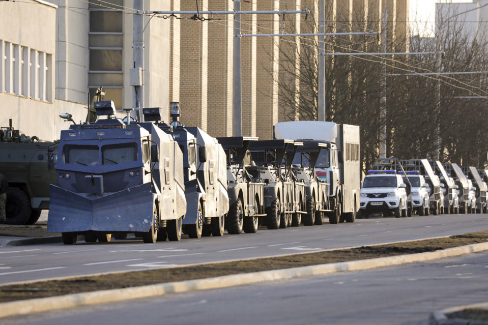 Police water cannons parked in a street to prevent a rally commemorating the founding of Belarus' 1918 proclamation of independence from Russia, in Minsk, Belarus, Thursday, March 25, 2021. Belarusian opposition have urged people to protest against repressions in the country and Lukashenko's regime. (BelaPan via AP)