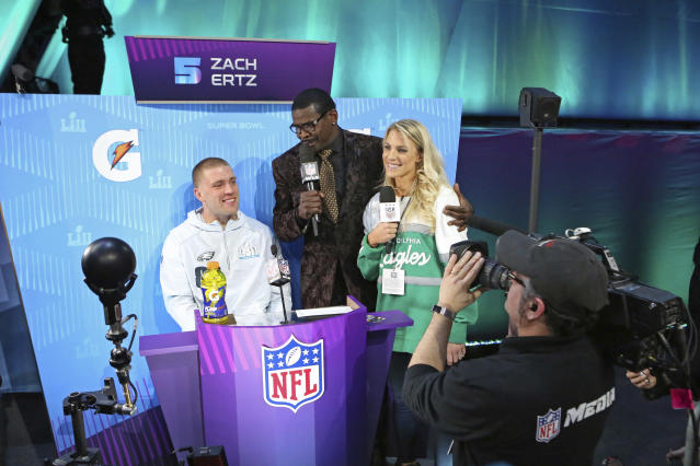 From (L-R) Philadelphia Eagles tight end Zach Ertz is interviewed by Michael Irvin, and Zach's wife Julie Ertz during opening night for the NFL Super Bowl 52 football game at Xcel Energy Center on Monday, Jan. 29, 2018, in St. Paul, Minn. (AP Photo/Gregory Payan)