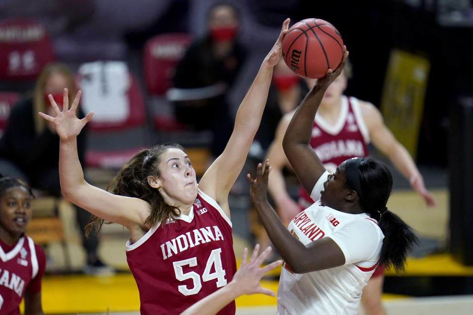 FILE - Indiana forward Mackenzie Holmes (54) blocks a shot by Maryland guard Ashley Owusu during the second half of an NCAA college basketball game in College Park, Md., in this Monday, Jan. 4, 2021, file photo. This week, No. 9 Indiana begins a new quest — dethroning No. 7 Maryland as tourney champs in Indianapolis. (AP Photo/Julio Cortez, File)