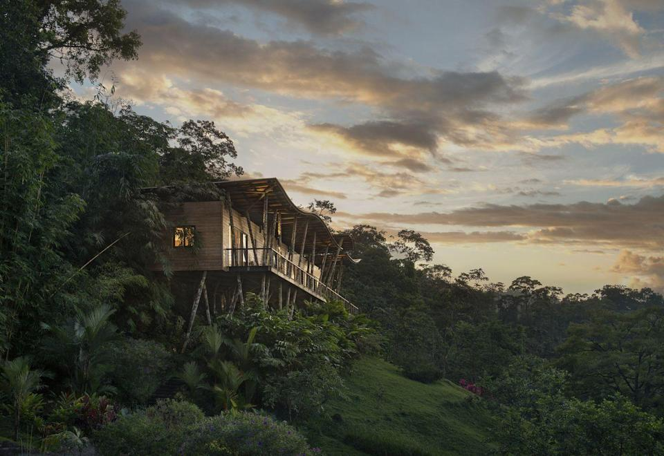 """<p>There are retreats in the jungle—and then there's this one, which takes lush living to new heights. For those looking to leave the world behind, Origins offers a mountainside hideaway deep in the rainforest. Each of its seven luxe cabins in the clouds is essentially a handcrafted nest perched amid the tree line. Couples never have to come down to earth. Why would you? You can cozy up in your own outdoor hot tub or on a canopy bed for two. Should you choose to relinquish your roost temporarily, you could try your hand at cooking local cuisine with the chefs from El Salto, pamper yourselves silly at the spa, or explore the local environs by foot, horseback, or boat. </p><p><a class=""""link rapid-noclick-resp"""" href=""""https://originslodge.com/"""" rel=""""nofollow noopener"""" target=""""_blank"""" data-ylk=""""slk:Book"""">Book</a></p>"""