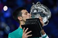Nine-time winner: Novak Djokovic kisses the Australian Open trophy