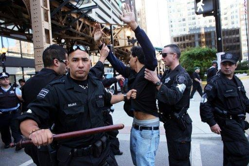 "Police arrest a protester during a demonstration near the NATO summit in Chicago, Illinois. US President Barack Obama and his NATO military allies ratified an ""irreversible"" roadmap to ""gradually and responsibly"" withdraw 130,000 combat troops by the end of 2014"
