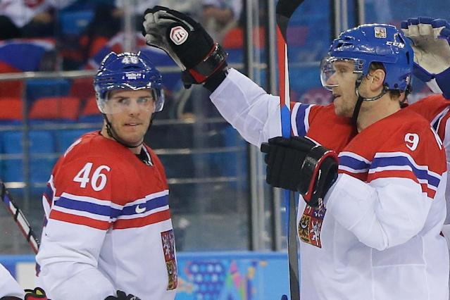 Czech Republic forward Milan Michalek congratulates Czech Republic forward David Krejci on his goal against Slovakia during the first period of the 2014 Winter Olympics men's ice hockey game at Shayba Arena, Tuesday, Feb. 18, 2014, in Sochi, Russia. (AP Photo/Matt Slocum)